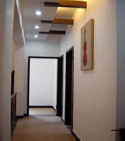 客厅进门玄关效果图:走廊吊顶装修效果图,风水设计很重要